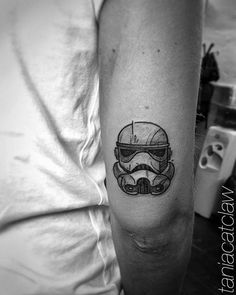 Sketchy stormtrooper tattoo on the back of the right arm.