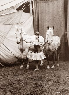 Have photos of circus girls everywhere.  Black and white in bright frames we can reuse on B 's wall