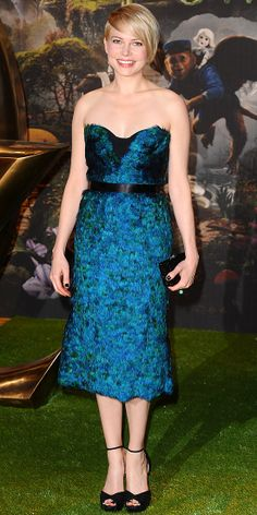 Michelle Williams WHAT SHE WORE Michelle Williams walked the yellow brick road at the London premiere of Oz: The Great and Powerful in a feathered Burberry bustier dress and Jimmy Choo platform sandals. - Look of the Day - InStyle