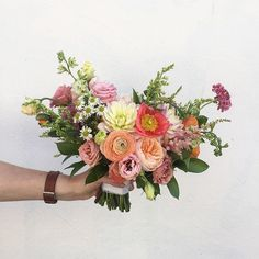 A bouquet for Erin by @theflowercult including poppies, dahlias and juliets. Congratulations beautiful bride!