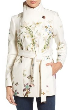 Free shipping and returns on Ted Baker London Spring Meadow Wool Blend Wrap Coat at Nordstrom.com. Wide lapels bring face-framing elegance to a short coat tailored from a plush wool blend infused with cashmere softness. A tie belt tipped with gleaming logo plates wraps it up.
