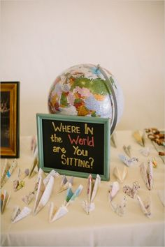 """""""Where in the world are you sitting?"""" Clever travel - map - paper airplane escort card station!"""