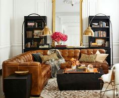 Amazing living room space. Chesterfield sofa, leopard and pink accents? Yaas.