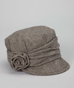 Top off a trendy ensemble with this chic cadet cap for a polished, put-together look. Boasting a trend-right silhouette with a classic herringbone pattern and a ravishing rosette accent, this haute hat is a fashionable finishing touch.