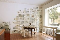 by café vux. Do this with little drawings and goodwill frames on wall be the front door!