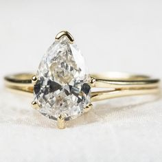 Precious Pear Cut Solitaire Diamond Ring 14k Gold from tanyastreasures on Ruby Lane