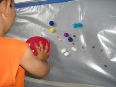 This is a fun idea! Put sticky paper up on the wall to make a sticky sensory wall! What can you get to stay put?
