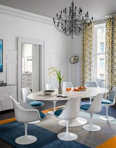 Saarinen Tulip Tables and Saarinen Dining Table in this Elias Associates-designed space | Photo by Trevor Tondro