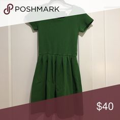 Green Ganni Dress from Anthropology Great condition, worn twice. I am a size 2/4 and it fits perfectly! Anthropologie Dresses