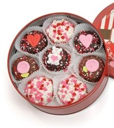 Romantic/Valentine Tin of 16 Belgian Chocolate Dipped & Decorated Oreos® - $34.95 - t's America's Favorite Cookie...all dressed up! These delicious Oreo Cookies® are perfect sweets for your sweetheart!  These cookies are hand-dipped in our delicious fine gourmet Belgian Chocolates - dark, milk and white - and decorated with an assortment of 100% Hand Crafted Royal Icing Valentine Decorations, assorted heart sprinkles, and non-pariels.