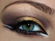 Gold and beige eye makeup with black and white liner