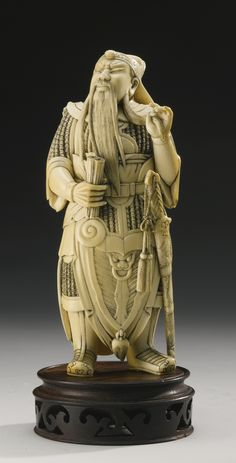 A CARVED IVORY FIGURE OF GUAN YU QING DYNASTY, 19TH CENTURY.