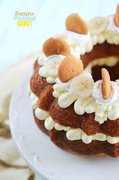 Banana Pudding Bundt Cake Recipe.  This cake is an easy one to throw together and looks and tastes wonderful – cool, creamy filling and topping with a moist banana pudding flavored cake with vanilla wafers baked inside.  Pin to your cake board!
