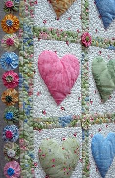 Beautiful hearts quilt using yo-yo method.