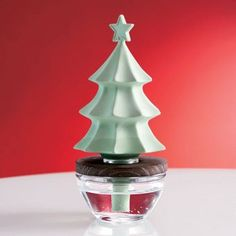 This porcelain evergreen tree topper is our own patented technology.  The wick releases continual fragrance from the clear glass base. Hands...