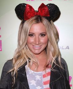 Ashley Tisdale showed her love of Minnie Mouse with a sequined pair of mouse ears with Minne's signature red bow topping her long blond hair at Perez Hilton's Mad Hatter Tea Party Birthday Celebration held at Siren Studios in Hollywood over the weekend.