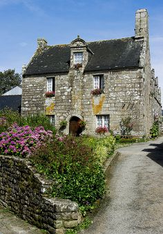 Charming grey stone house in Locronan, Brittany - France - the Celts Migrated through northern Spain and the area of Brittany, France prior to many of them moving onto the British Isles and ending up in Scotland, Ireland and Wales.