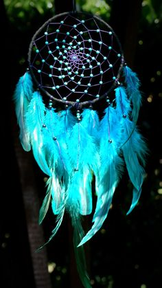 The light and dark blue of the dreamcatcher makes it look majestic Dream Catcher Painting, Dream Catcher Decor, Dream Catcher Mobile, Blue Dream Catcher, Beautiful Dream Catchers, Dreamcatcher Background, Dreamcatcher Wallpaper, Dreamcatchers, Blue Feathers