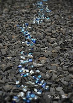 How I Created A Garden Feature With Black Shale And Blue Glass Gems - The Problem: When we moved into our present home the previous owner was a passionate garde…