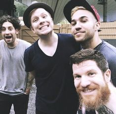 three young emos pictured with their father