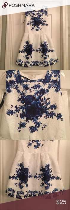 White and blue floral tunic/dress I have never worn this dress. Got it off a website and was a pain to return. I am 5'4 and the length goes to my mid thigh. I like dresses a little longer. Can't pull off the short look but some can! So come grab this never worn piece !! Dresses Mini