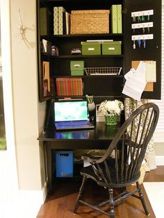 Organized corner home office in a hutch :: She shares how each box/product keeps them organized in one small space.  Great solution if you don't have an extra room for an office.