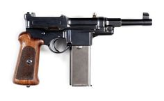 This is an exceptionally rare Mauser M1906-08 self-loading pistol with a 20-round magazine, serial number 51. It is chambered in caliber 9x21mm (DWM case 487B). Mauser made fewer than 100 such pistols, with the highest recorded number believed to be number 77.