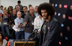 Sep 1, 2016; San Diego, CA, USA; San Francisco 49ers quarterback Colin Kaepernick (right) talks to media after the game against the San Diego Chargers at Qualcomm Stadium. Mandatory Credit: Jake Roth-USA TODAY Sports