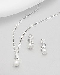 sterling silver earrings and pendant set with cubic zircon and decorated with fresh water pearl