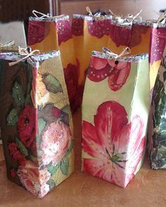Embalagens tetrpack de suco e leite se transformam em pacotes de presente
