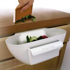 Kitchen Art Scrap Trap $7.39 - OMG I NEED THIS. such a good idea for making my tiny kitchen a liiiitttleee more useful