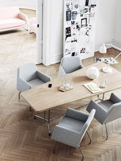 Bright dining room with a conference table vibe. Great for a casual, modern  workspace. #modernoffice #interiors