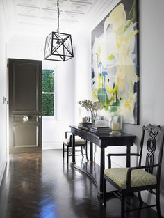I love the use of oversized art in this entryway. Sometimes, one piece of large art can have a greater impact than several smaller pieces.