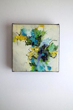 Blue flower painting...abstract floral... This small abstract painting makes a big impact with its many layers of acrylic paint. The edges are painted black. It can hang on a wall or sit on a shelf. I use velcro on the back of my paintings to adher them to my carpet covered