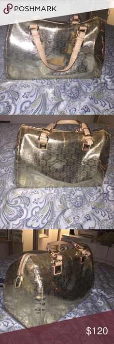 f1d91d19a597e2 Shop Women's Michael Kors Gold size OS Bags at a discounted price at  Poshmark.