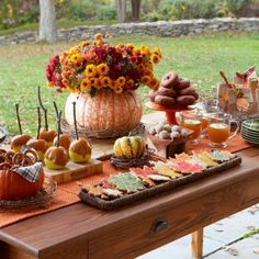 fall party decor _ Dress up your fall party dessert table with some natural textures.  Use old wooden crates or hollowed out pumpkins, lined with fabric napkins or even leftover fabric scraps as serving dishes,  add a little twisting grapevine to the table, and throw in a few mums and you will have an unforgetably beautiful fall display