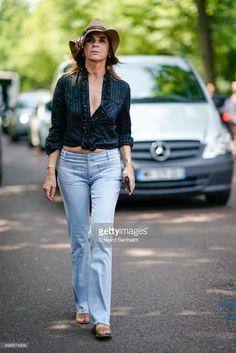 Carine Roitfeld wears a camel hat, a black low neck shirt, blue denim jeans pants, outside the Balenciaga show, during Paris Fashion Week - Menswear Spring/Summer 2018, on June 21, 2017 in Paris, France.
