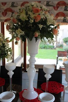 Tall white centrepiece with white candle holders