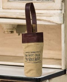 """The Mona B """"I'm Vintage"""" canvas wine bag is a conversation starter with a clever saying and makes a great gift for wine lovers."""