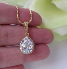 This necklace is very sophisticated and luxury. Made with yellow gold plated chain, bails and clear cubic zirconia pear shape pendant framed with Bride Necklace, Bridesmaid Earrings, Diamond Earrings, White Gold, Pendant Necklace, Chain, Unique Jewelry, Handmade, Etsy