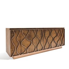 This phenomenal credenza exhales style, luxury and a design that will crease in to your memory. A fascinating and exclusive piece with sinuous and elegant lines accommodated by dimensional copper-leaf accents on the doors and a metal-copper plinth base. The body is mantled in goatskin and the interior is finished in ebonizedmahogany, carrying 2 adjustable shelves.  Finish on photos: Color: Cognac Goatskin Topcoat: Matte  Size:W83 x D20.50 x H33 inches