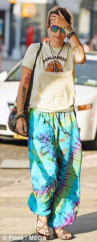 Retro: The 19-year-old IMG Model - who relies on stylist Sonia Young - flaunted her eccentric hippie style in tie-dye drawstring baggy pants, brown sandals, and a Baja-striped backpack