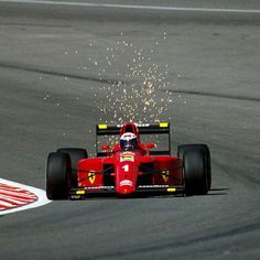 Alain Prost drive his Ferrari 641, #1, Eau Rouge, Belgian Grand Prix, Spa-Francorchamps, 1990 (finished 2nd).