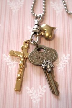 Vintage Gold tone Crucifix and Vintage Key Pendant Necklace. $24.50, via Etsy.