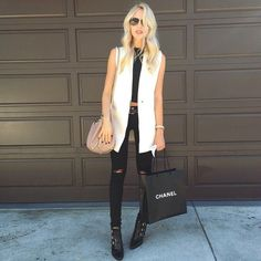 belt + black distressed jeans (jbrand) + black buckled ankle booties (jimmy choo) + black high neck shell + long white tailored vest (helmut lang)
