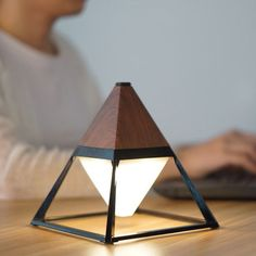 Light up your life with our Pyramid Lamp…this waterproof and portable lamp is an ideal companion when you're studying late in the evening.you can even take it outside with you if you're an outdoor study person! Rustic Lamps, Garden Lamps, Luminaire Design, Wooden Lamp, Lampe Led, Unique Lamps, Bedroom Lamps, Bedroom Decor, Home Lighting
