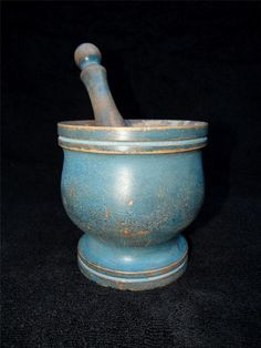 Antique old mortar and pestle in paint.