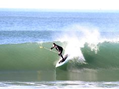 "Wardog pulling into a deep one on the 9'2"" WD in seafoam carbon..."
