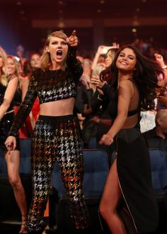 Selena Gomez and Taylor Swift  dance in the audience of the 2015 MTV Video Music Awards in Los Angeles, CA.