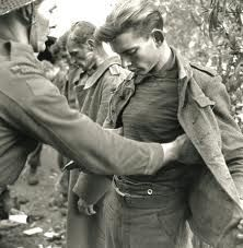 German prisoners of war being searched in Ortona, Italy.